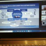 "Laptop-Bildschirm mit Präsentationsfolie mit dem Titel ""Prediction of Failures is a Core Element for a Customer oriented Mobility Business."""