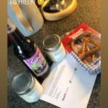 """Screenshot einer Instagram Story: Im Hintergrund Brezeln, Aufstrich und eine Flasche Saft - darüber der Text: """"@bayfid_ Guten Appetit"""""""